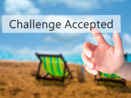 Challenge Accepted - Hand pressing a button on blurred background concept . Business, technology, internet concept. Stock Photo