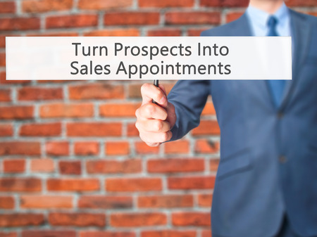Turn Prospects Into Sales Appointments - Businessman hand holding sign. Business, technology, internet concept. Stock Photo