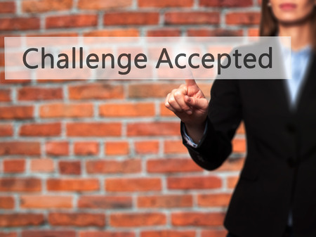 Challenge Accepted - Businesswoman hand pressing button on touch screen interface. Business, technology, internet concept. Stock Photo
