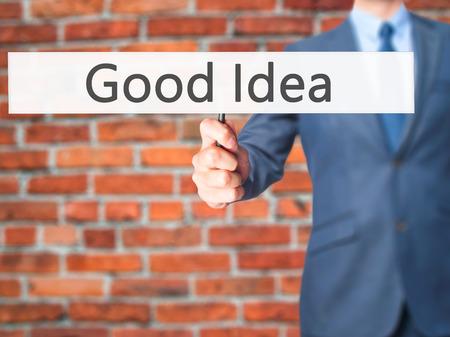 innovator: Good Idea - Businessman hand holding sign. Business, technology, internet concept. Stock Photo Stock Photo