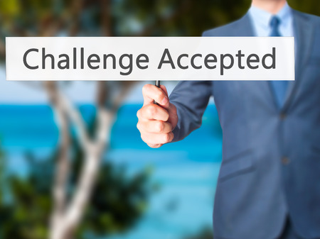 difficult task: Challenge Accepted - Businessman hand holding sign. Business, technology, internet concept. Stock Photo