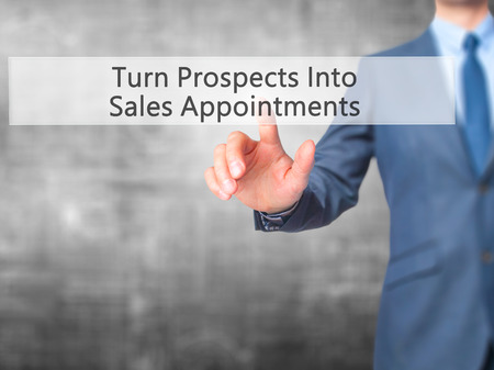 prospecting: Turn Prospects Into Sales Appointments - Businessman hand pressing button on touch screen interface. Business, technology, internet concept. Stock Photo Stock Photo