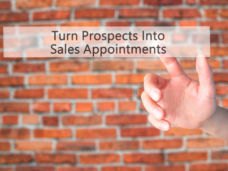 immediate: Turn Prospects Into Sales Appointments - Hand pressing a button on blurred background concept . Business, technology, internet concept. Stock Photo