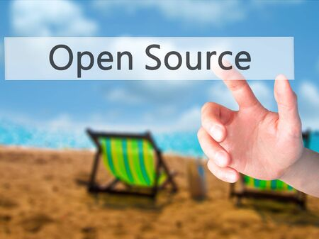 Open Source - Hand pressing a button on blurred background concept . Business, technology, internet concept. Stock Photo