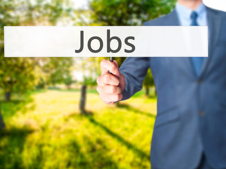 joblessness: Jobs - Business man showing sign. Business, technology, internet concept. Stock Photo