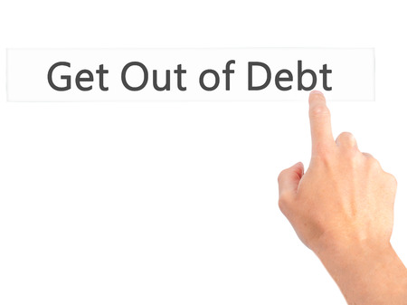 debt goals: Get Out of Debt - Hand pressing a button on blurred background concept . Business, technology, internet concept. Stock Photo