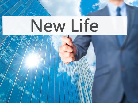 job deadline: New Life - Business man showing sign. Business, technology, internet concept. Stock Photo