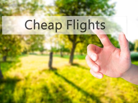 Cheap Flights - Hand pressing a button on blurred background concept . Business, technology, internet concept. Stock Photo