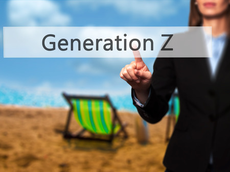Generation Z - Businesswoman pressing modern  buttons on a virtual screen. Concept of technology and  internet. Stock Photo