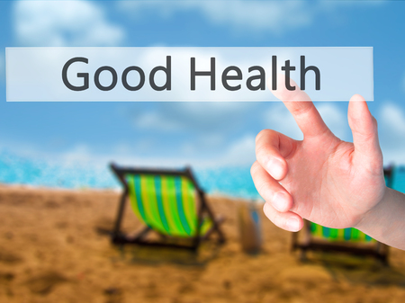 Good Health - Hand pressing a button on blurred background concept . Business, technology, internet concept. Stock Photo