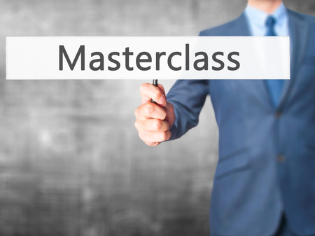 elearn: Masterclass - Business man showing sign. Business, technology, internet concept. Stock Photo