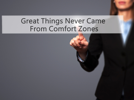 zones: Great Things Never Came From Comfort Zones - Businesswoman pressing modern  buttons on a virtual screen. Concept of technology and  internet. Stock Photo