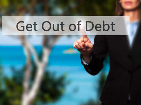 liquidity: Get Out of Debt - Businesswoman pressing modern  buttons on a virtual screen. Concept of technology and  internet. Stock Photo Stock Photo