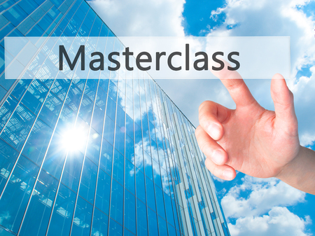 elearn: Masterclass - Hand pressing a button on blurred background concept . Business, technology, internet concept. Stock Photo