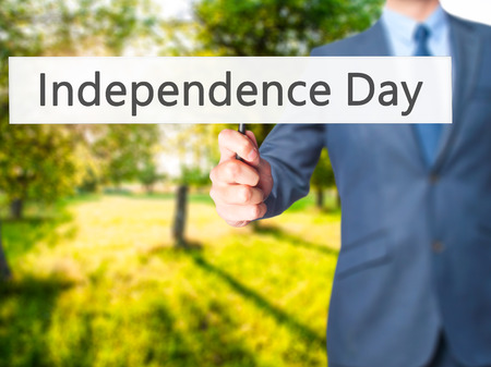 Independence Day - Business man showing sign. Business, technology, internet concept. Stock Photo Stock Photo