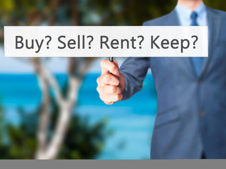 retain: Buy? Sell? Rent? Keep? - Business man showing sign. Business, technology, internet concept. Stock Photo