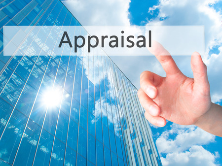 assessed: Appraisal - Hand pressing a button on blurred background concept . Business, technology, internet concept. Stock Photo