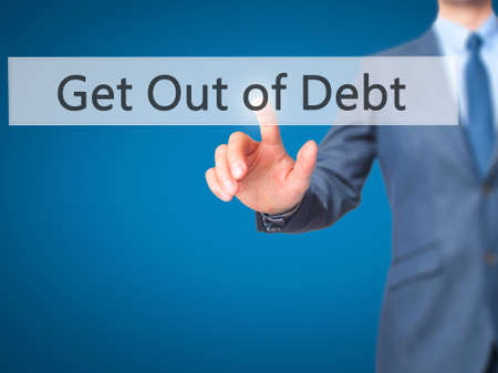 get out: Get Out of Debt - Businessman press on digital screen. Business,  internet concept. Stock Photo