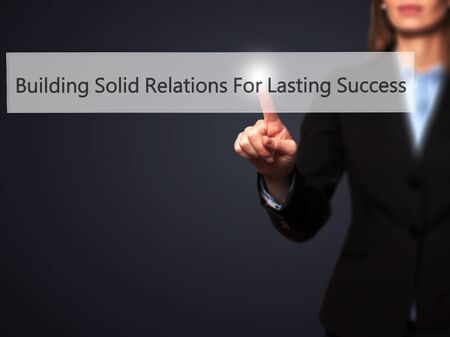 lasting: Building Solid Relations For Lasting Success - Businesswoman pressing modern  buttons on a virtual screen. Concept of technology and  internet. Stock Photo Stock Photo