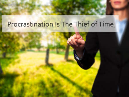Procrastination Is The Thief of Time - Businesswoman pressing modern  buttons on a virtual screen. Concept of technology and  internet. Stock Photo Stock Photo