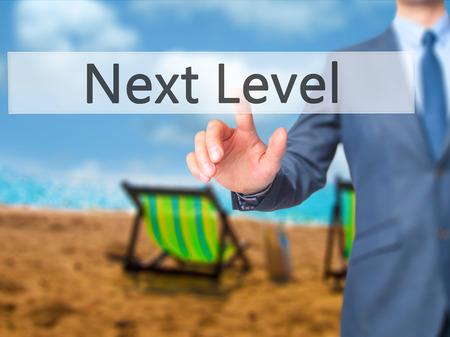 higher intelligence: Next Level - Businessman press on digital screen. Business,  internet concept. Stock Photo Stock Photo