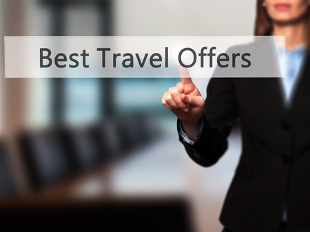 brazilian caribbean: Best Travel Offers - Hand pressing a button on blurred background concept . Business, technology, internet concept. Stock Photo Stock Photo