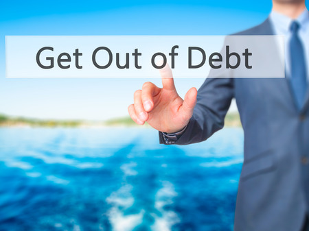 bank records: Get Out of Debt - Businessman press on digital screen. Business,  internet concept. Stock Photo