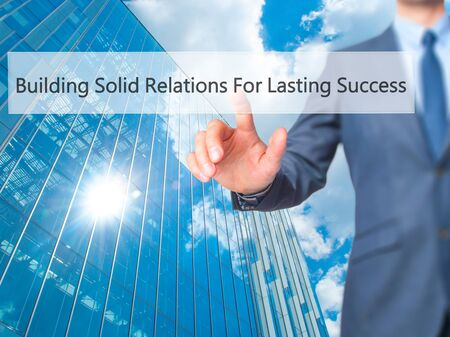 lasting: Building Solid Relations For Lasting Success - Businessman click on virtual touchscreen. Business and IT concept. Stock Photo