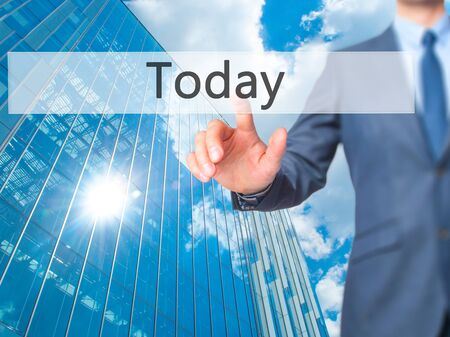 Today - Businessman click on virtual touchscreen. Business and IT concept. Stock Photo