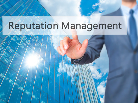 reputable: Reputation Management - Businessman click on virtual touchscreen. Business and IT concept. Stock Photo Stock Photo