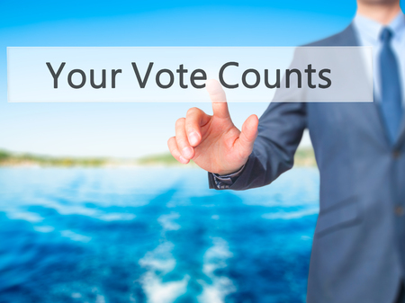 libertarian: Your Vote Counts - Businessman click on virtual touchscreen. Business and IT concept. Stock Photo Stock Photo