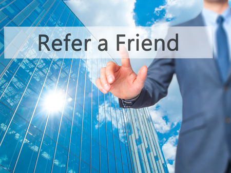 Refer a Friend - Businessman click on virtual touchscreen. Business and IT concept. Stock Photo Stock Photo