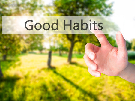 good habits: Good Habits - Hand pressing a button on blurred background concept . Business, technology, internet concept. Stock Photo Stock Photo