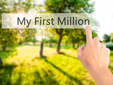 MILLION: My First Million - Hand pressing a button on blurred background concept . Business, technology, internet concept. Stock Photo