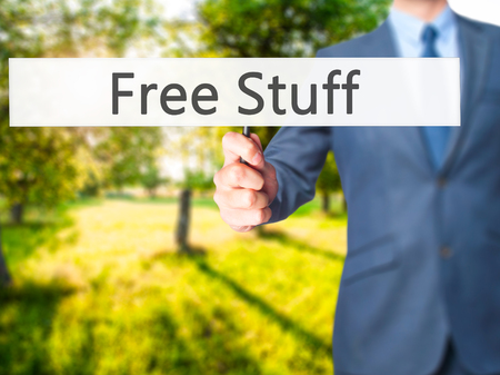 Free Stuff - Businessman hand holding sign. Business, technology, internet concept. Stock Photo Stock Photo