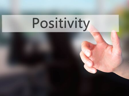 street wise: Positivity - Hand pressing a button on blurred background concept . Business, technology, internet concept. Stock Photo