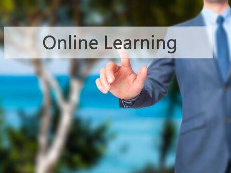 elearn: Online Learning - Businessman hand pressing button on touch screen interface. Business, technology, internet concept. Stock Photo