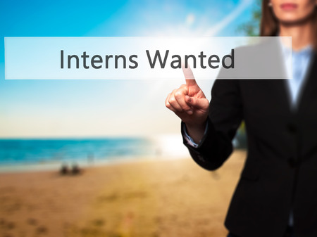 apprenticeship employee: Interns Wanted - Businesswoman hand pressing button on touch screen interface. Business, technology, internet concept. Stock Photo