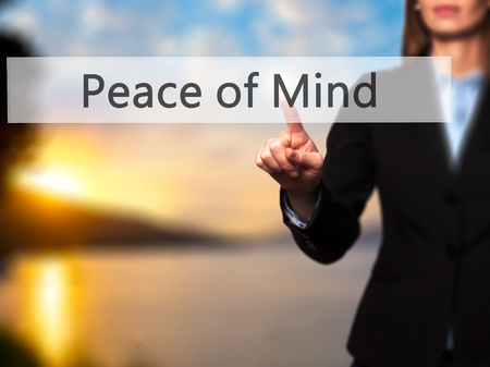 sense of security: Peace of Mind - Businesswoman hand pressing button on touch screen interface. Business, technology, internet concept. Stock Photo
