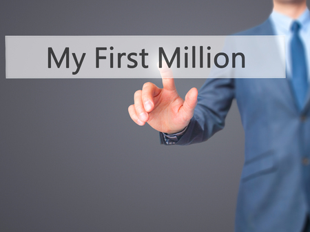 opulence: My First Million - Businessman hand pressing button on touch screen interface. Business, technology, internet concept. Stock Photo Stock Photo