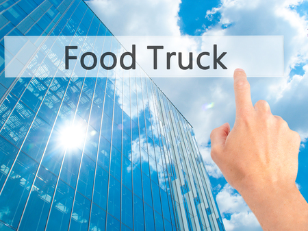 Food Truck - Hand pressing a button on blurred background concept . Business, technology, internet concept. Stock Photo