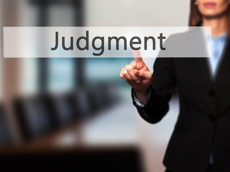 lawful: Judgment - Isolated female hand touching or pointing to button. Business and future technology concept. Stock Photo