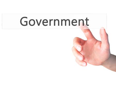 gov: Government - Hand pressing a button on blurred background concept . Business, technology, internet concept. Stock Photo