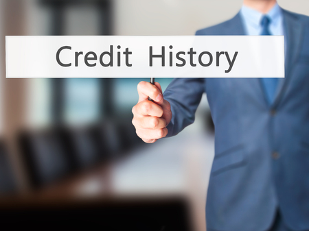 creditworthiness: Credit History - Business man showing sign. Business, technology, internet concept. Stock Photo