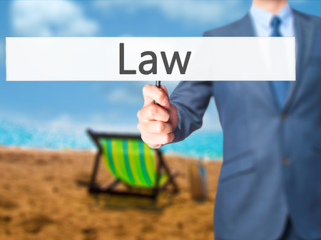 Law - Business man showing sign. Business, technology, internet concept. Stock Photo Stock Photo