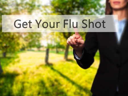 Get Your Flu Shot - Isolated female hand touching or pointing to button. Business and future technology concept. Stock Photo