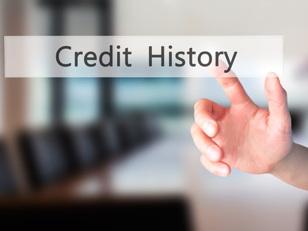 customer records: Credit History - Hand pressing a button on blurred background concept . Business, technology, internet concept. Stock Photo