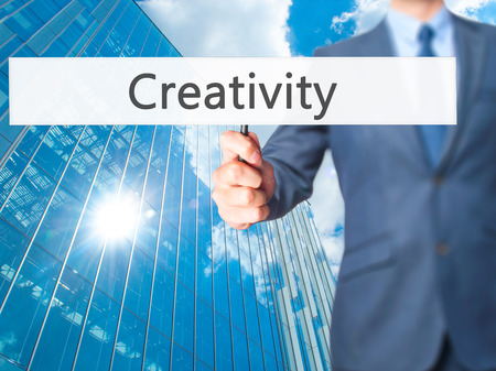 Creativity - Business man showing sign. Business, technology, internet concept. Stock Photo