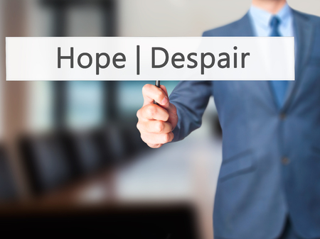 wishful: Hope Despair - Business man showing sign. Business, technology, internet concept. Stock Photo