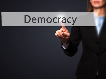 parliamentary: Democracy - Isolated female hand touching or pointing to button. Business and future technology concept. Stock Photo